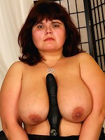 Big Mature MILF uses her beachball sized juggs to titfuck!