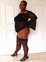 Thick ebony Naughtya get frisky and takes a white cock in her cooze by humping it on top