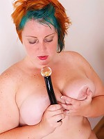 Plump puss with an awesome rack enjoys her sex toy